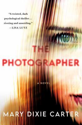 The photographer : a novel Book cover